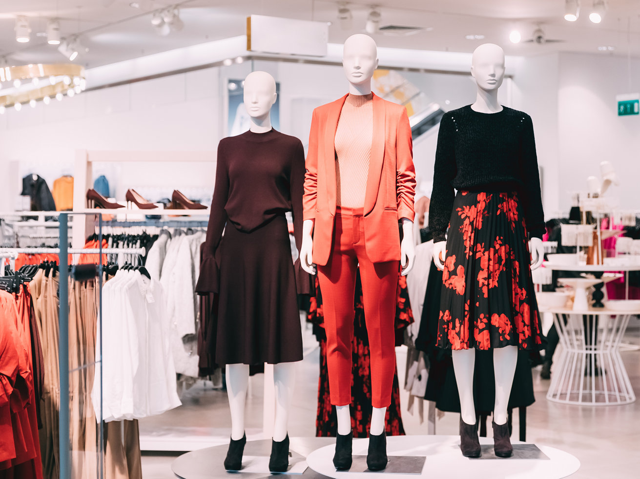 Mannequins displaying womens clothing in bright store